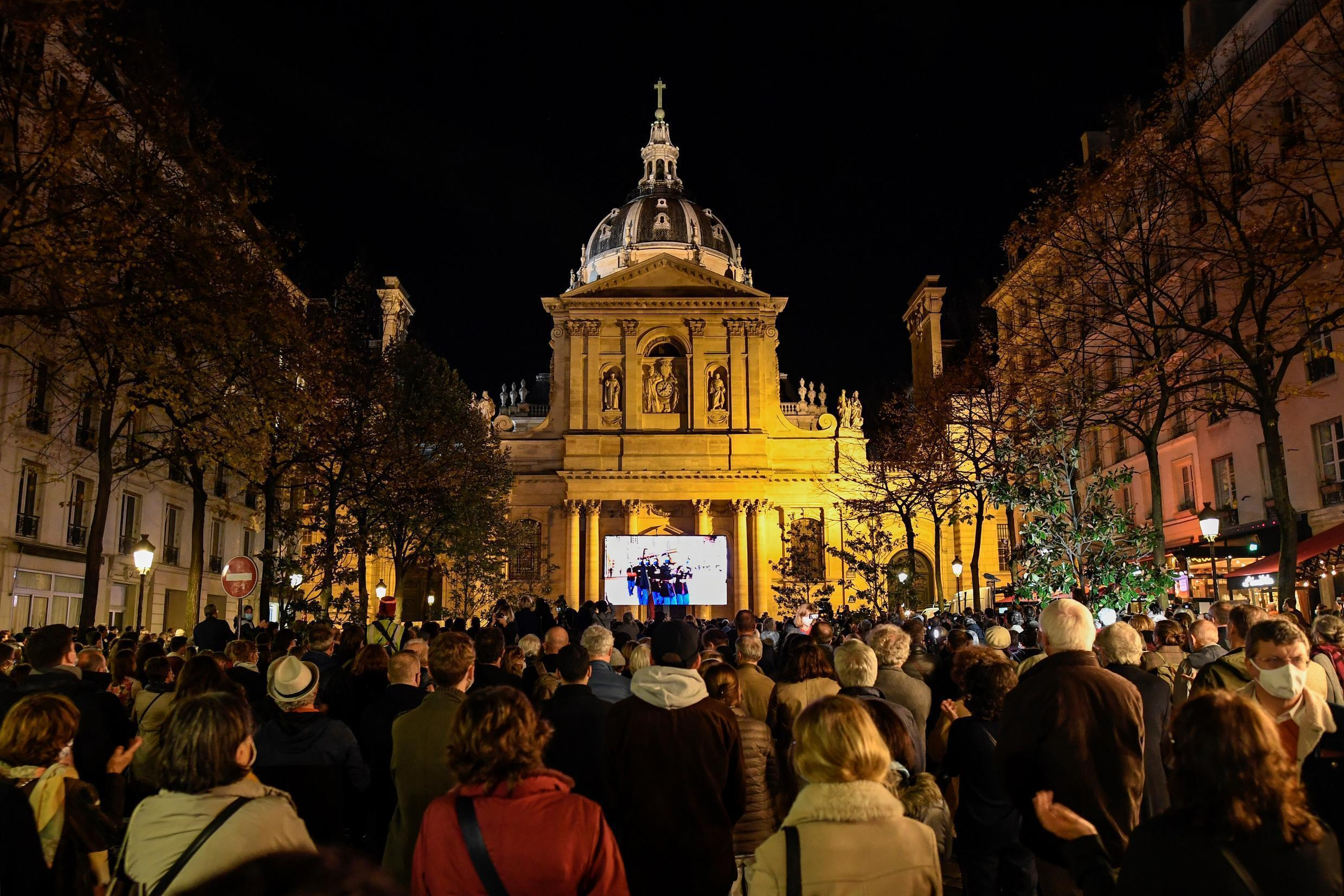 Hundreds gathered outside the Sorbonne University to watch the ceremony commemorating the murdered teacher
