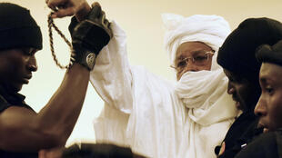 Former Chadian dictator Hissene Habre (C, pictured being escorted to court in 2015) has been granted two months' leave from prison as his jail is being used for new detainees in coronavirus quarantine