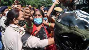 Demonstrators in New Delhi protest Wednesday over the death of a 19-year-old woman allegedly gang-raped in India's latest horrific sexual assault