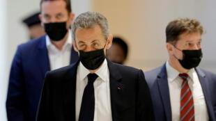 Sarkozy back in court