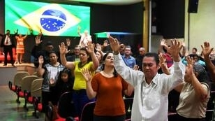 Worshipers pray at an evangelical church in Brasilia, for the recovery of Brazilian right-wing presidential candidate Jair Bolsonaro, who was stabbed while campaigning