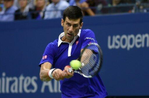 Novak Djokovic returns the ball to Roger Federer during their 2015 US Open final match in New York on September 13, 2015.