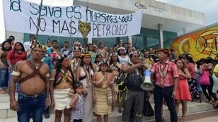 Waorani people from Ecuador's Amazon rainforest gathered in the town of Puyo to protest plans to open up their lands to oil exploration