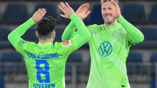 Two strikes: Wolfsburg midfielder Renato Steffen (left) celebrates scoring