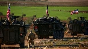 US forces operating near on the outskirts of the northern Syrian city of Manbij in March 2017: President Donald Trump has ordered a complete withdrawal of US forces from Syria