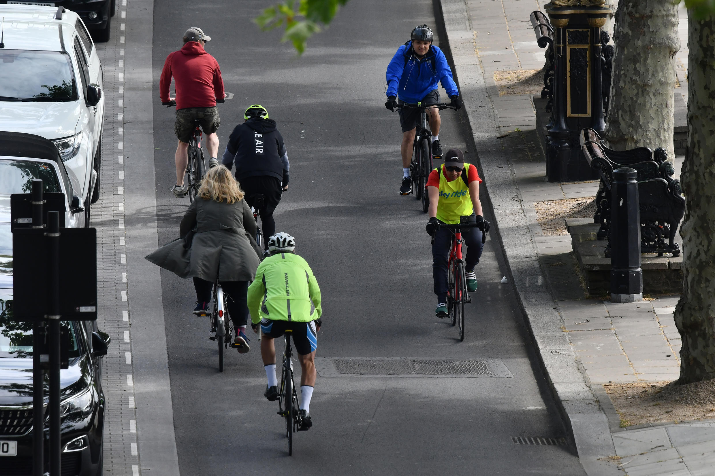 Cyclists travel in the cycle lane along the Embankment in central London on May 16, 2020, following an easing of lockdown rules in England during the novel coronavirus pandemic.