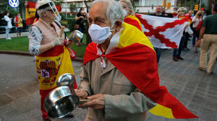 """Demonstrators wrapped in Spanish flags protest at what rightwing parties have dubbed a """"brutal confinement"""" after a fifth state of emergency extension"""