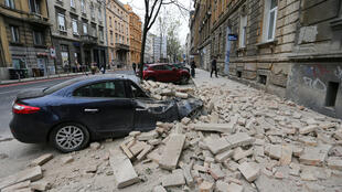 A damaged car is seen following an earthquake in Zagreb, Croatia, March 22, 2020.