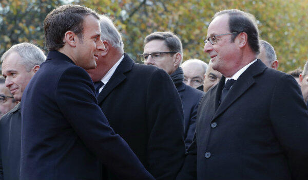 Philippe Wojazer, AFP | French President Emmanuel Macron (left) and his predecessor, François Hollande, attend commemorations marking two years since the Nov. 13 attacks in Paris.