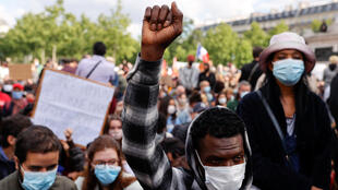 A demonstrator wearing a protective face mask raises his fist during a protest at the Place de la Republique square, following the death of George Floyd in Minneapolis police custody, in Paris, France June 9, 2020.