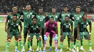 The Zambian national team pose before a 2022 Africa Cup of Nations qualifier in Algeria