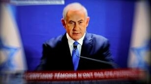 This picture taken from I-24 television shows Israeli Prime Minister Benjamin Netanyahu delivering a statement live at the prime minister's office in Jerusalem on January 07, 2019