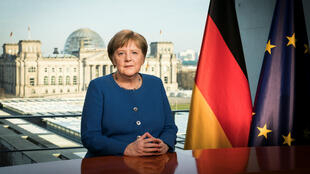 Geman Chancellor Angela Merkel announces on Sunday, March 22, 2020, tough new measures to ban outdoor meetings of more than two people due to the coronavirus outbreak.