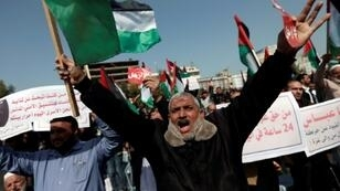 Demonstrators attend a protest in Gaza City demanding Palestinian president Mahmud Abbas to step down