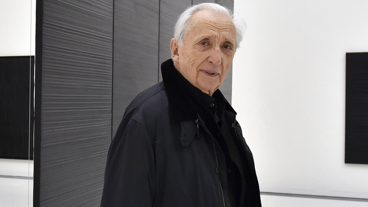 Art's man in black gets Louvre tribute for 100th birthday