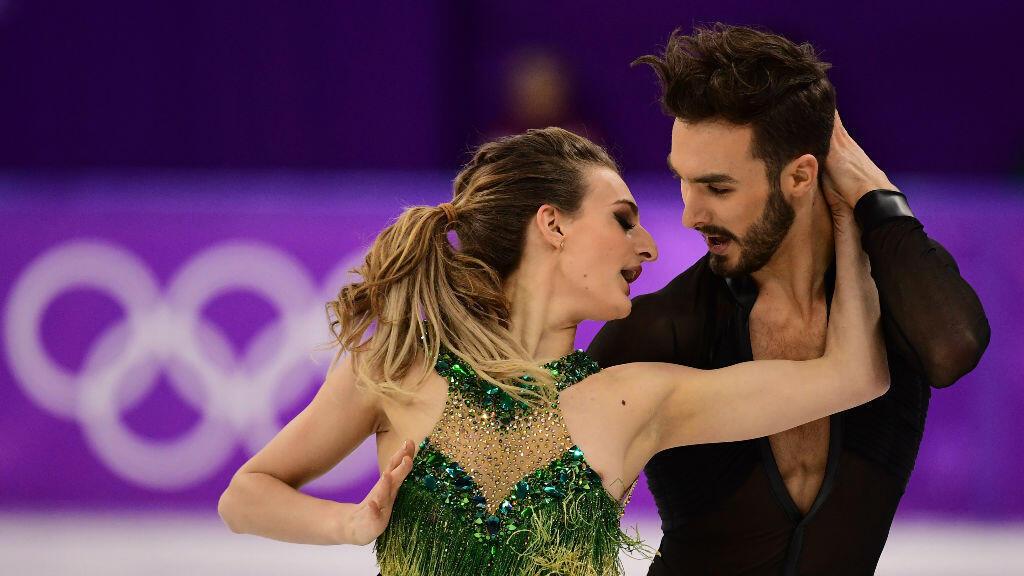 Gabriella Papadakis et Guillaume Cizeron lors de leur première épreuve de patinage artistique aux JO d'hiver, le 19 février 2018.