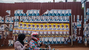 Posters of the candidates for Uganda's Jan. 14 presidential election along a street in Kampala, January 6, 2021.