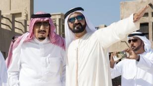 الشيخ محمد بن راشد آل مكتوم مستقبلا الملك سلمان في دبي في ديسمبر 2016.