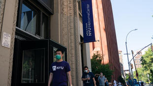 New York University students wait in line for a COVID-19 test before the fall semester opens