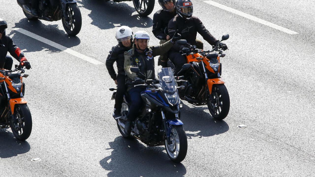 Brazil's Bolsonaro fined for maskless motorcyle rally - France 24