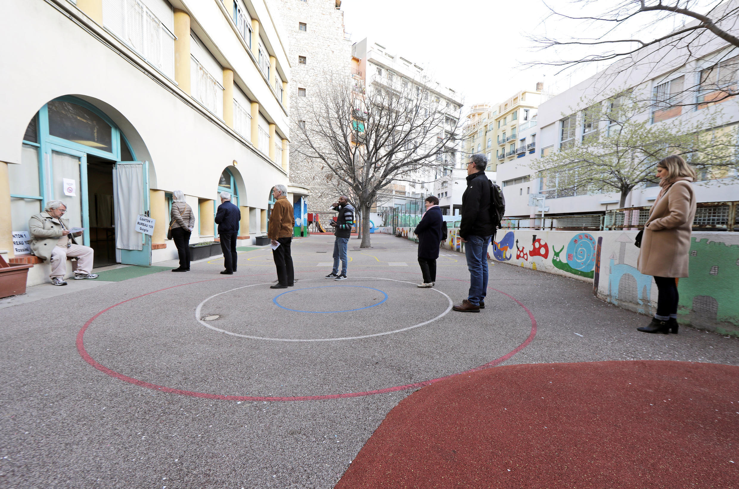 Voters keep their distance while voting in municipal elections in Nice.