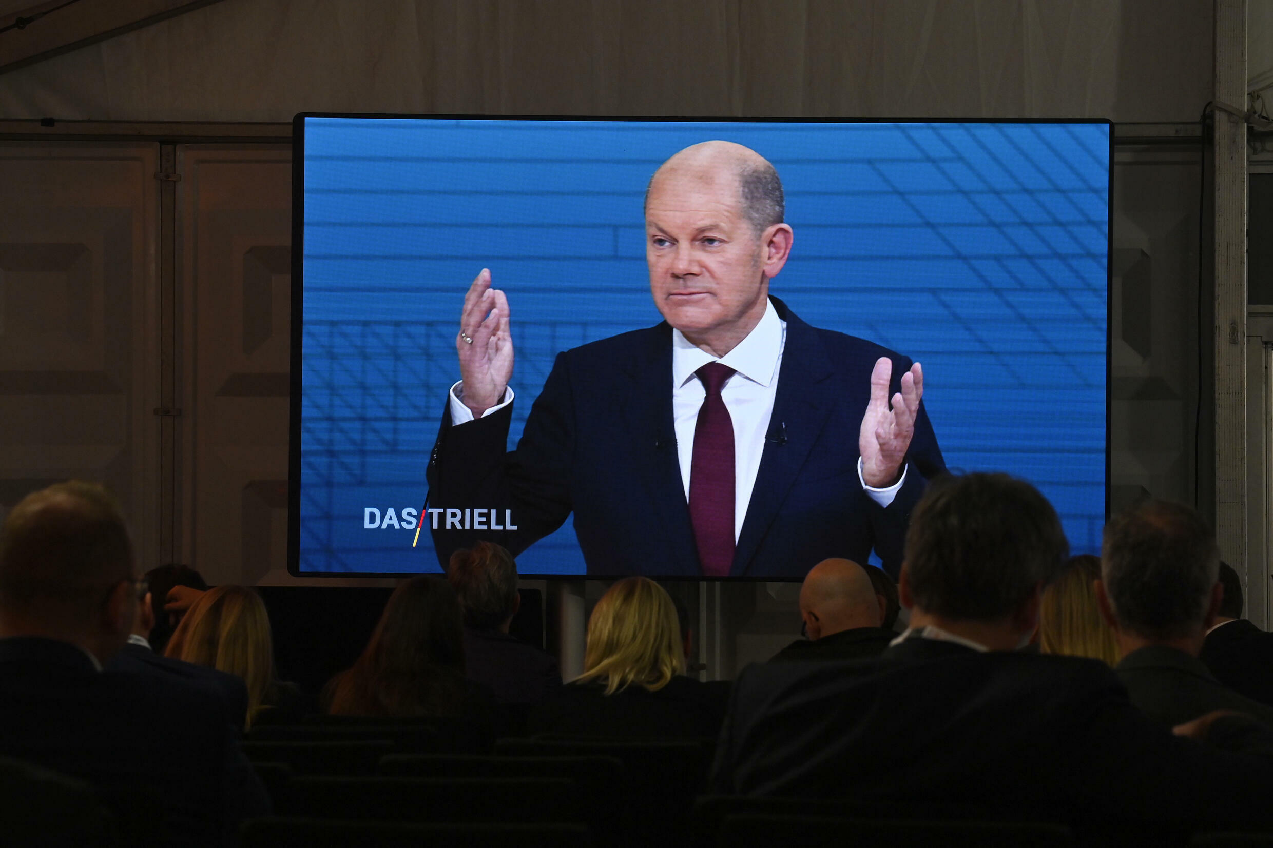 The SPD's leading candidate, Finance Minister Olaf Scholz, is in pole position to take Merkel's crown