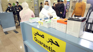 Egyptian Quarantine Authority employees prepare to scan body temperatures of incoming travellers at Cairo International Airport on February 1, 2020.