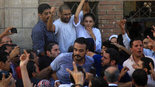 Egyptian activist Sanaa Seif and her brother Alaa Abdel Fattah, seen here during a 2014 prison furlough to attend their father's funeral, have both spent long spells in custody