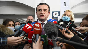 Albin Kurti, leader of the Vetevendosje (Selfdetermination) movement, speaks to the press after casting his vote during Parliamentary elections at a polling station in Pristina on February 14, 2021.
