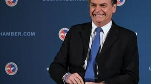 """Brazil's President Jair Bolsonaro at the US Chamber of Commerce in Washington, DC on March 18, 2019. He will meet Tuesday, March 19, with President Donald Trump in what officials say is an opportunity to create a new north-south """"axis."""""""