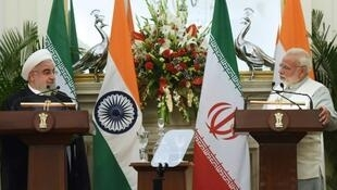 Iranian President Hassan Rouhani meets Indian Prime Minister Narendra Modi on a February 2018 visit to New Delhi