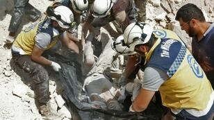 """The Syrian Civil Defense, also known as the """"White Helmets"""", pictured in September 2018, saves those wounded in attacks on rebel zones"""