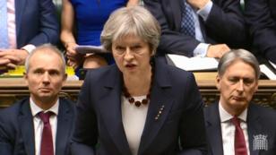 La Première ministre britannique, Theresa May, lors d'une déclaration devant la Chambre des communes le 14 mars 2014 à Londres.