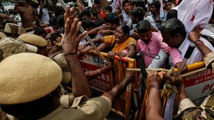 Police officers stop demonstrators during a protest against a new citizenship law in Chennai, India, on December 21, 2019.