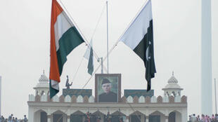 The Indian and Pakistan flags fly during the daily beating of the retreat ceremony at the Wagah Border