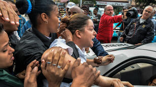 A member of the Ladies in White opposition movement is arrested during a demonstration in Havana in December 2014.
