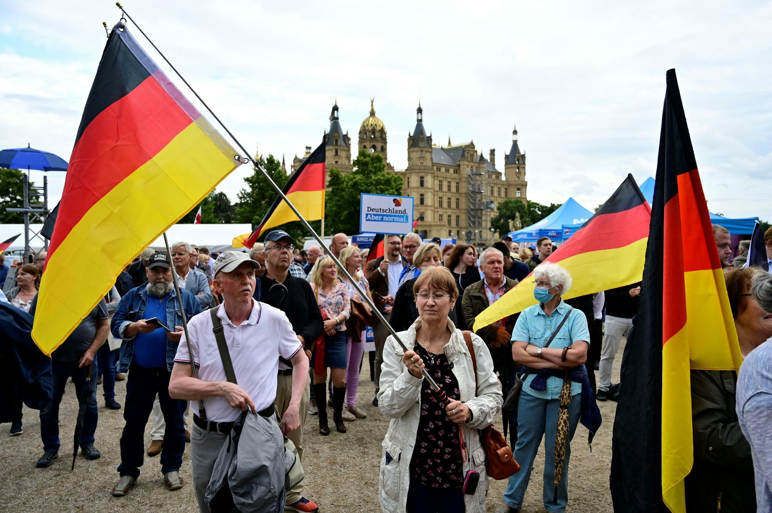 AfD supporters pictured at a rally in Schwerin, northern Germany, on August 10, 2021