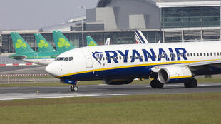 A Ryanair passenger plane is pictured at Dublin Airport in Ireland on March 23, 2020.