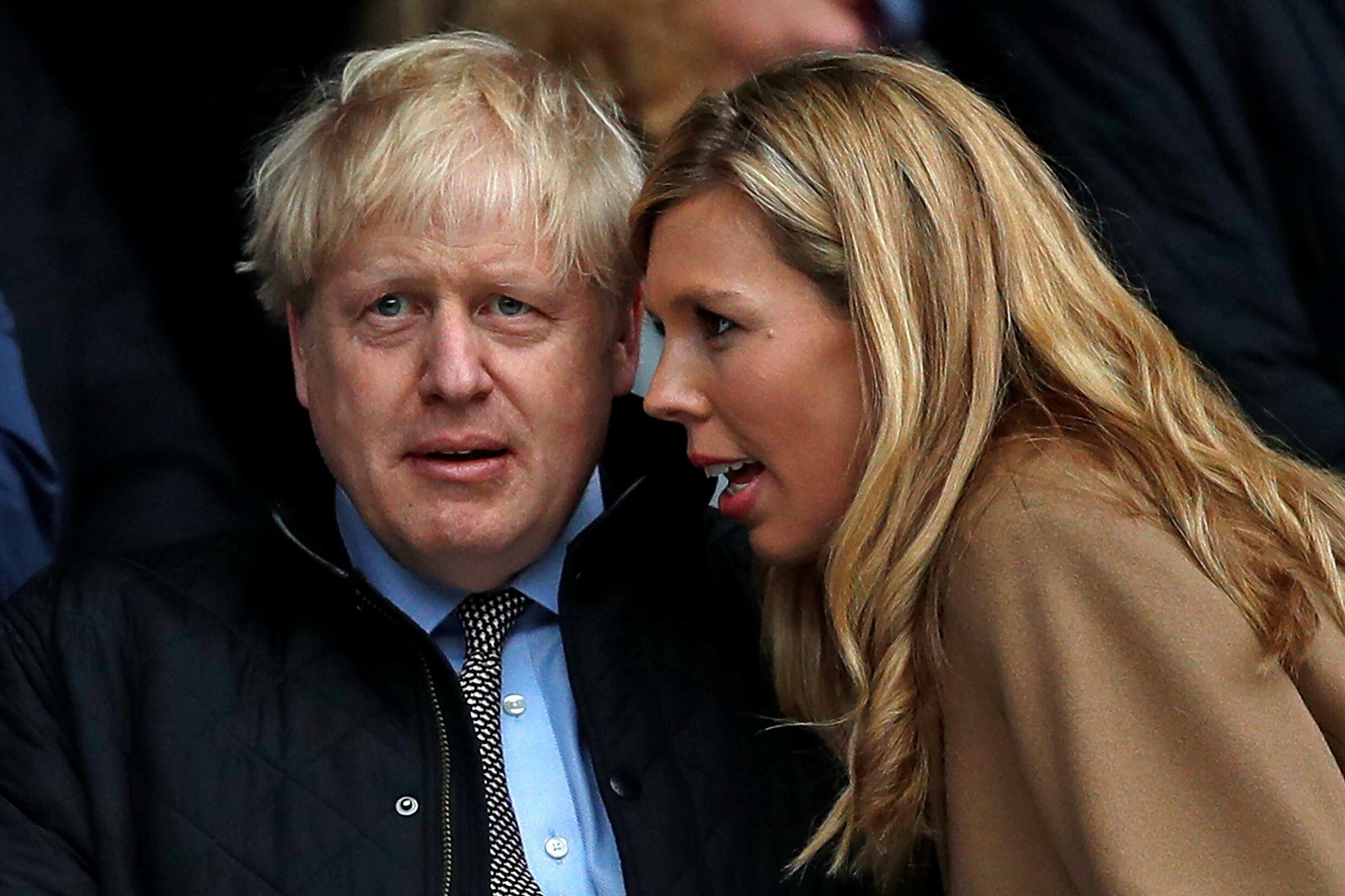 The 56-year-old Boris Johnson and his fiancee Carrie Symonds, 33, shown here in March 2020, wed in front of close friends and family