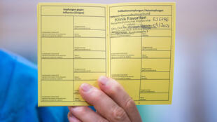 Medical personnel holds a vaccination certificate with a registered Pfizer-Biontech Covid-19 coronavirus vaccination at the Favoriten Clinic in Vienna, Austria, on December 27, 2020.
