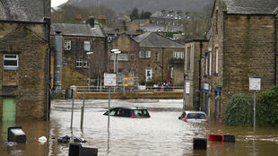 Cars are seen submerged as flood water covers the roads and car parks in Mytholmroyd, northern England, on February 9, 2020, after the River Calder burst its banks when Storm Ciara swept across the country.