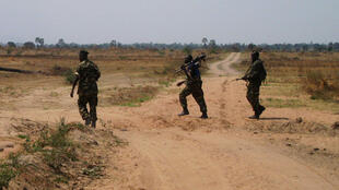 Burundian army soldiers patrol on a road near Rukoko, a few miles north of the capital Bujumbura