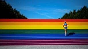 A man walks on steps covered in rainbow colors for Pride Month at Franklin D. Roosevelt Four Freedoms Park on June 15, 2019 in New York City