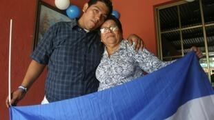Hanssel Vasquez (L) poses with his mother in Managua after he was among 50 opposition prisoners released under a controversial new law granting amnesty to protesters and police involved in last year's deadly uprising against President Daniel Ortega