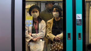 Japanese tourists wear face protection masks in the metro in Paris as the country is hit by an outbreak of coronavirus disease (COVID-19), France, March 11, 2020.