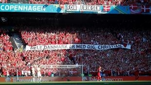 Danish supporters take part in a moment of applause for Christian Eriksen during the Euro 2020 game against Belgium