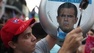 Un manifestant réclame la démission du gouverneur de Porto Rico à San Juan le 23 juillet 2019.