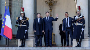 French President Emmanuel Macron welcomes Ukrainian President Volodymyr Zelensky ahead of a summit in Paris on December 9, 2019.