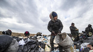 A young Syrian sifts through a garbage dump on January 17; more than half of children in war-torn Syria are left without education, the UN children's agency UNICEF said Sunday