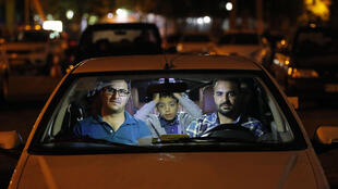Deprived by the coronavirus of the opportunity to pray at mosques during Ramadan, Iranians are jumping into their cars to attend drive-in religious ceremonies